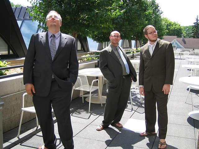 Flip-flops with suits (Photo by Flickr user Joel Gillman)