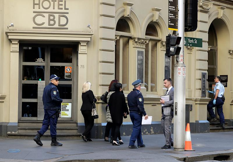 Police work at a scene where a man attempted to stab multiple people in Sydney, Australia, Tuesday, Aug. 13, 2019.