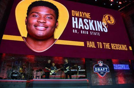 Apr 25, 2019; Nashville, TN, USA; Graphic of Dwayne Haskins (Ohio State) is selected as the number fifteen overall pick to the Washington Redskins in the first round of the 2019 NFL Draft in Downtown Nashville. Haskins was not in attendance. Mandatory Credit: Christopher Hanewinckel-USA TODAY Sports