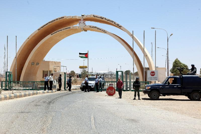 This photo taken on June 25, 2014 shows Jordanian security forces standing guard at the Al-Karameh border point with Iraq