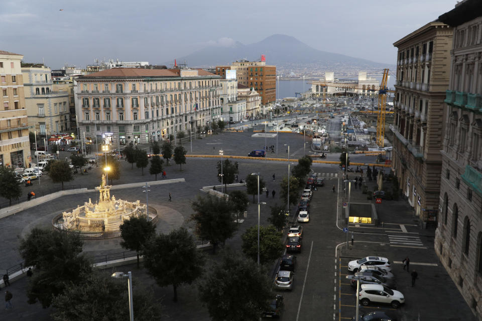 A general view of the town hall square in Naples, in the region of Campania, Italy, Friday, Nov. 13, 2020. The regions of Campania and Tuscany were designated red zone on Friday, signaling the dire condition of a hospitals struggling with a surge of new admissions. (AP Photo/Gregorio Borgia)