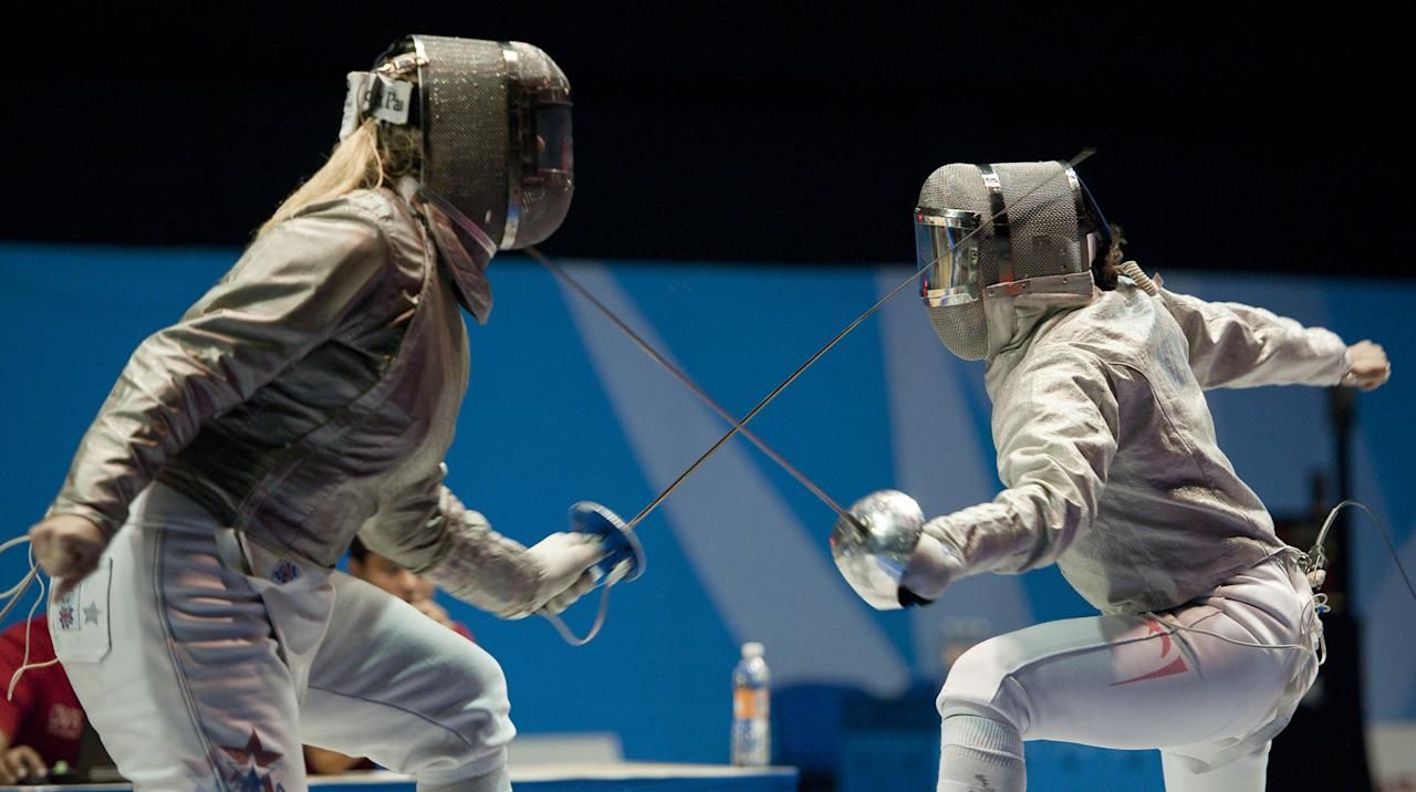 Mariel Zagunis (L) of the USA competes against Angelica Larios of Mexico in a team's sabre gold medal match, during the Guadalajara 2011 Pan American Games, in Guadalajara, Mexico, on October 28, 2011.  AFP PHOTO/OMAR TORRES (Photo credit should read OMAR TORRES/AFP/Getty Images)