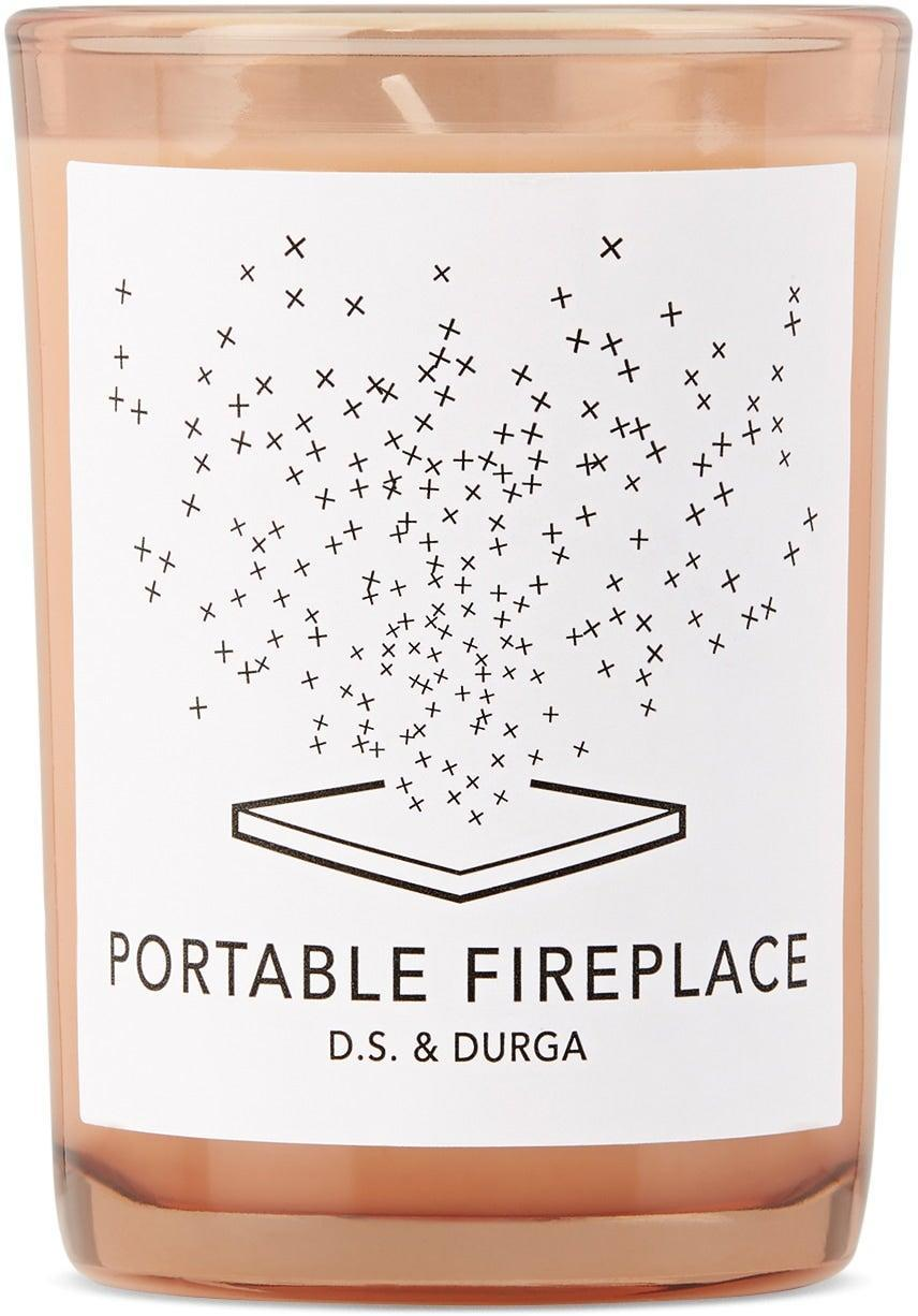 """<h3>D.S. & Durga Portable Fireplace Candle </h3><br>This luxury candle — filled with notes of pine to cedar, ash oak, and birch wood — as one <a href=""""https://www.amazon.com/D-S-Durga-Portable-Fireplace-Candle/dp/B00VSDMGSM#customerReviews"""" rel=""""nofollow noopener"""" target=""""_blank"""" data-ylk=""""slk:Amazon reviewer"""" class=""""link rapid-noclick-resp"""">Amazon reviewer</a> frankly put it, """"really does smell like a wood fire.""""<br><br><em>Shop <a href=""""https://www.ssense.com/en-us/everything-else/product/ds-and-durga/portable-fireplace-candle-7-oz/6615731"""" rel=""""nofollow noopener"""" target=""""_blank"""" data-ylk=""""slk:SSENCE"""" class=""""link rapid-noclick-resp""""><strong>SSENCE</strong></a></em><br><em>Shop <a href=""""https://www.amazon.com/D-S-Durga-Portable-Fireplace-Candle/dp/B00VSDMGSM"""" rel=""""nofollow noopener"""" target=""""_blank"""" data-ylk=""""slk:Amazon"""" class=""""link rapid-noclick-resp""""><strong>Amazon</strong></a></em><br><br><strong>D.S. & Durga</strong> Portable Fireplace Candle, 7 oz, $, available at <a href=""""https://go.skimresources.com/?id=30283X879131&url=https%3A%2F%2Fwww.ssense.com%2Fen-us%2Feverything-else%2Fproduct%2Fds-and-durga%2Fportable-fireplace-candle-7-oz%2F6615731"""" rel=""""nofollow noopener"""" target=""""_blank"""" data-ylk=""""slk:SSENSE"""" class=""""link rapid-noclick-resp"""">SSENSE</a>"""