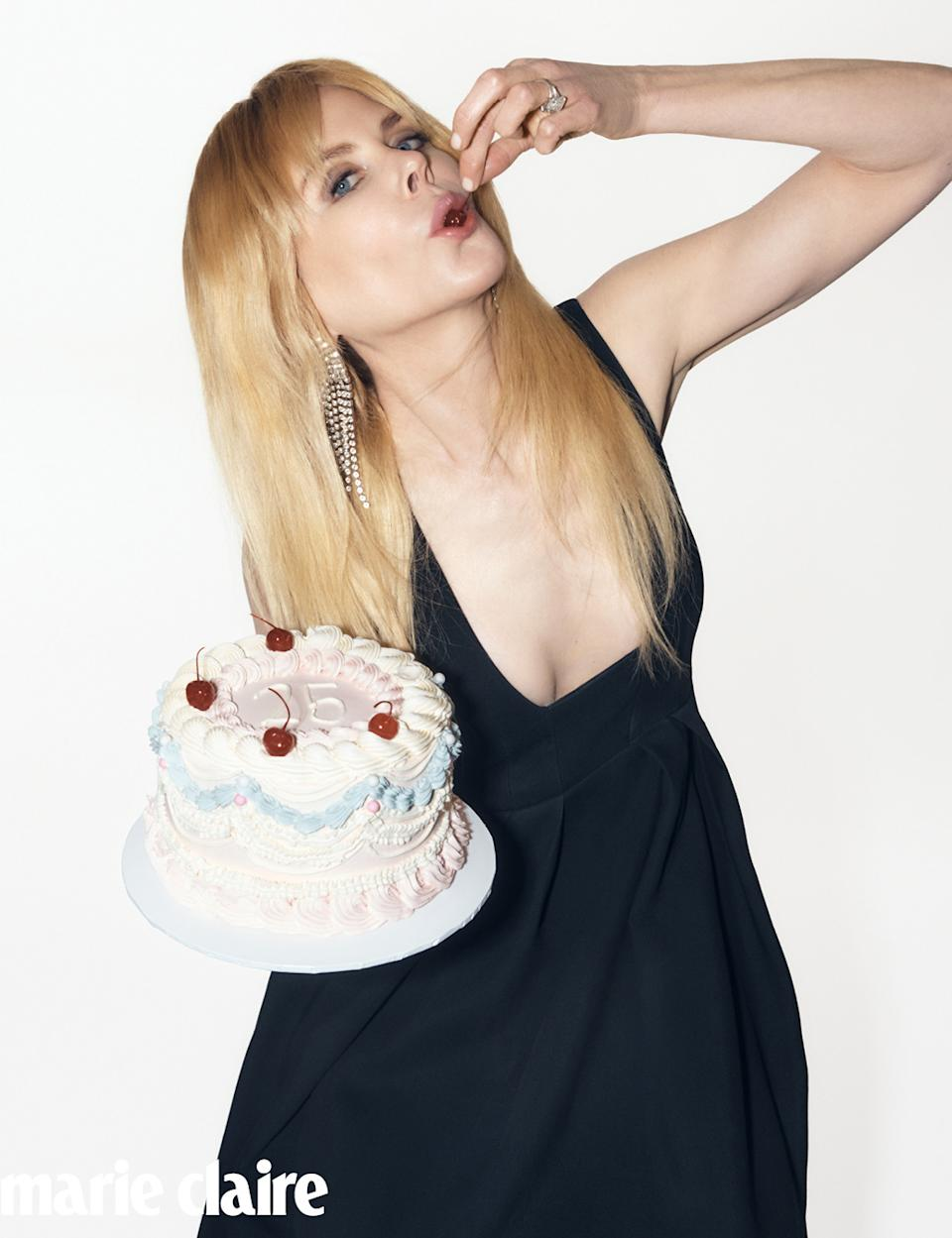Nicole Kidman eating a cherry from a cake on Marie Claire Australia