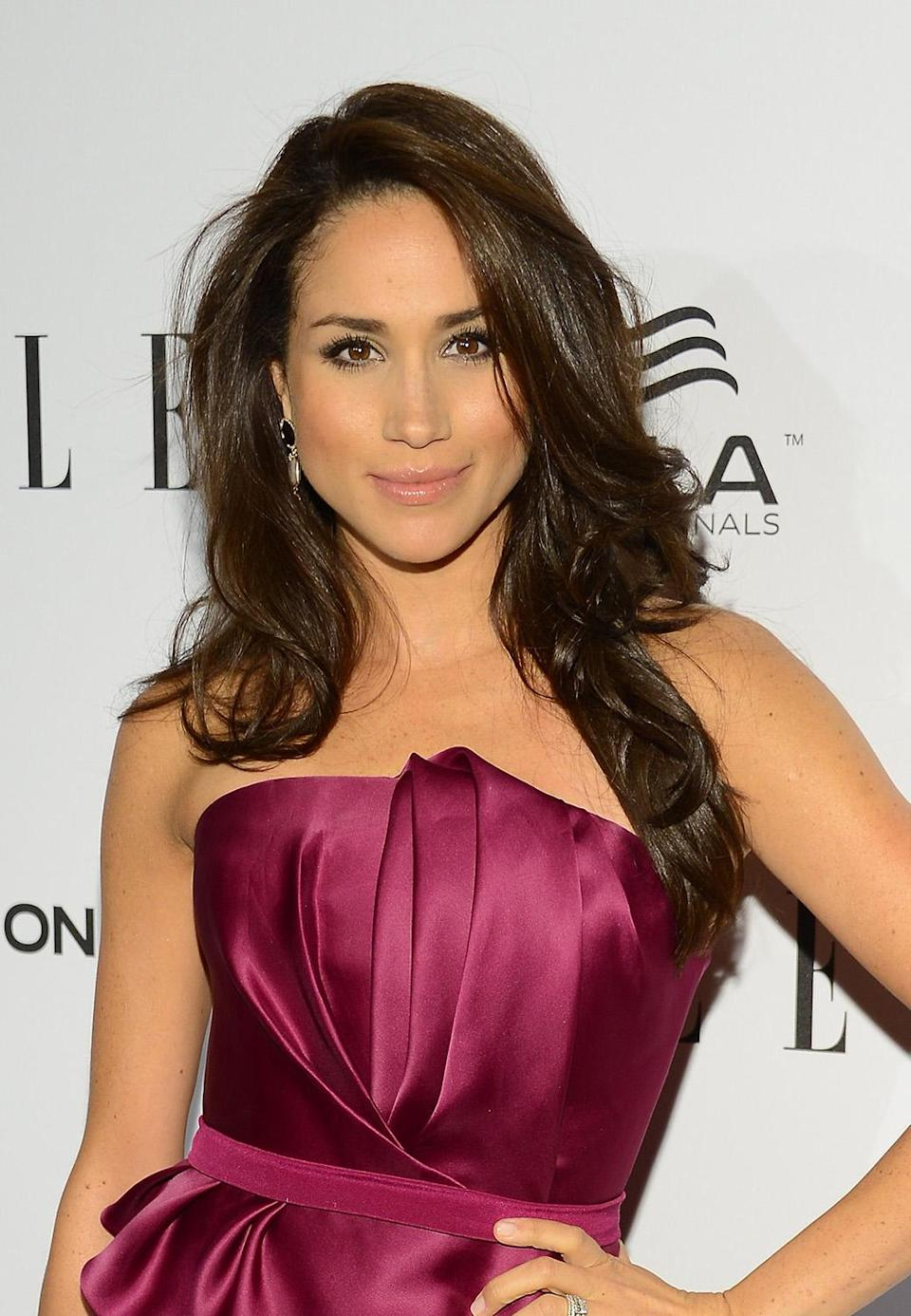 <p>At Elle's 2013 Women in Television Celebration, Markle struck a pose sporting a volumious blowout. (Photo: Michael Kovac/Getty Images for ELLE) </p>