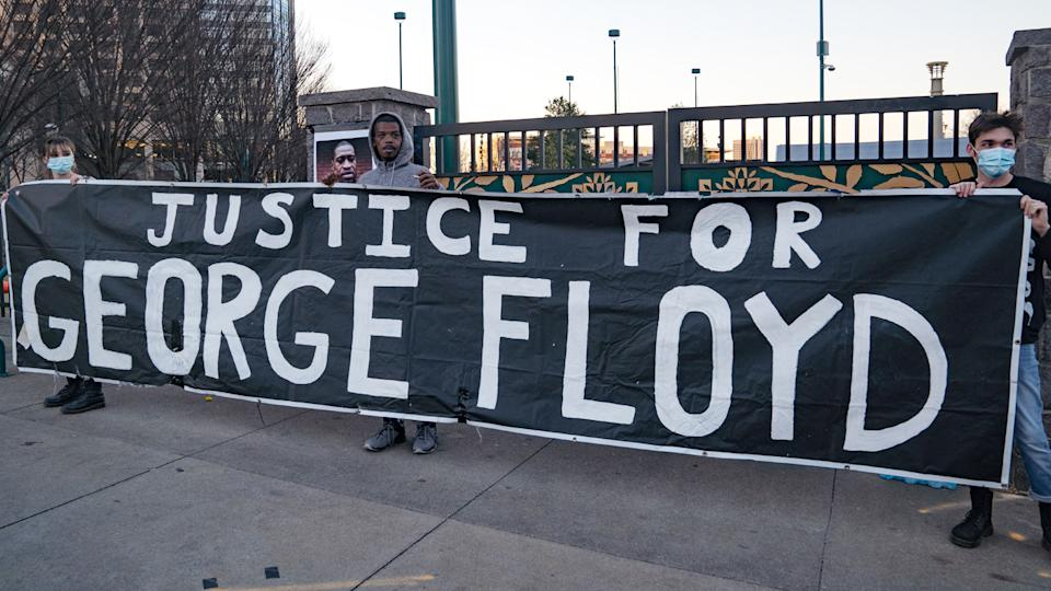 Demonstrators hold a vigil in honor of George Floyd on March 8, 2021 in Atlanta, Georgia. (Megan Varner/Getty Images)