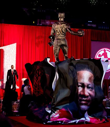 ATLANTA, GA - MARCH 05: The Atlanta Hawks honor NBA Legend Dominique Wilkins as they unveil a statue in his name at Philips Arena on March 5, 2015 in Atlanta, Georgia. NOTE TO USER: User expressly acknowledges and agrees that, by downloading and/or using this photograph, user is consenting to the terms and conditions of the Getty Images License Agreement. (Photo by John Bazemore-Pool/Getty Images)