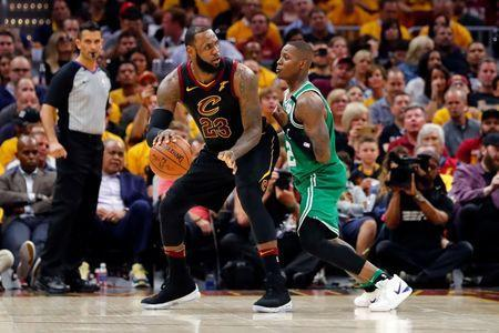 May 19, 2018; Cleveland, OH, USA; Cleveland Cavaliers forward LeBron James (23) drives against Boston Celtics guard Terry Rozier (12) in game three of the Eastern conference finals of the 2018 NBA Playoffs at Quicken Loans Arena. Mandatory Credit: Rick Osentoski-USA TODAY Sports