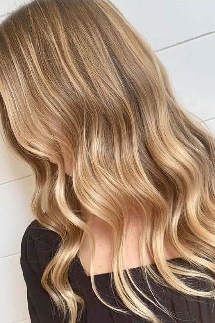 """<p>This mane by <a href=""""https://www.instagram.com/jackhowardcolor/"""" target=""""_blank"""">colorist Jack Howard</a> looks smoother than a vat of Tupelo Honey. Ribbons of wheat blonde will catch that warm autumn sunlight all season long. </p>"""