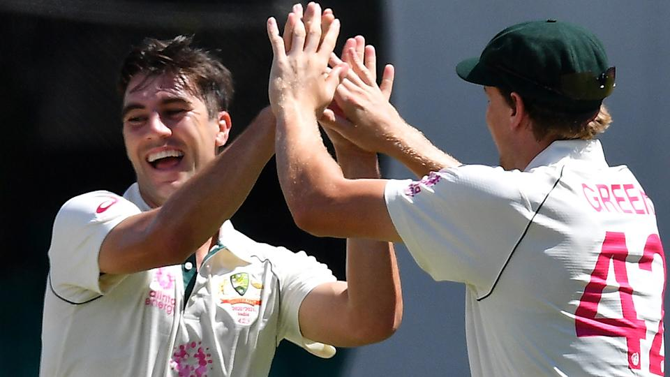 Australian paceman Pat Cummins celebrates his wicket of Indian captain Ajinkya Rahane with teammates on day three of the third cricket Test match at Sydney Cricket Ground. (Photo by SAEED KHAN/AFP via Getty Images)