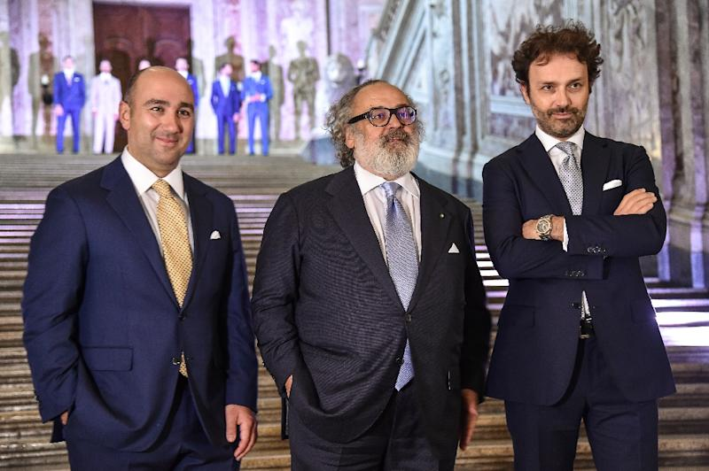 The luxury brand of Stefano Ricci, seen with sons Filippo and Niccolo, has outfitted celebrities from Andrea Bocelli to Morgan Freeman and Tom Cruise, as well as world leaders such as Nelson Mandela (AFP Photo/Andreas SOLARO)