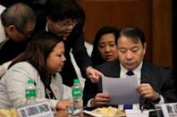 Lorenzo Tan (R), president and chief executive officer of the Rizal Commercial Banking Corp (RCBC) reads a document assisted by his lawyers during a money laundering hearing at Senate in Manila March 15, 2016. REUTERS/Romeo Ranoco