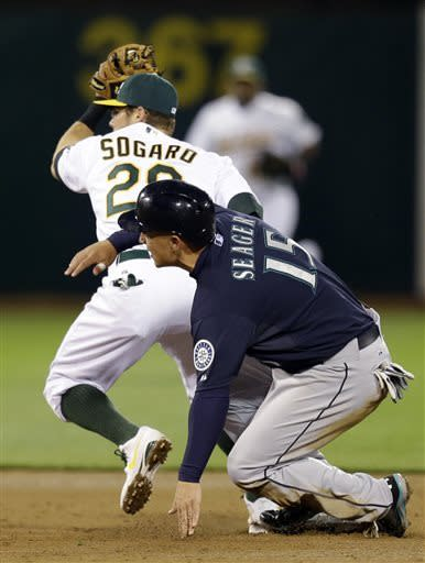 Seattle Mariners' Kyle Seager (15) is forced out at second base on a fielders choice by Oakland Athletics second baseman Eric Sogard in the third inning of a baseball game Tuesday, April 2, 2013, in Oakland, Calif. (AP Photo/Ben Margot)
