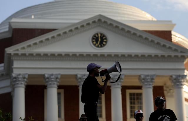 <p>Protesters with the group Students Act Against White Supremacy speak on the campus of the University of Virginia during an event marking the one year anniversary of a deadly clash between white supremacists and counter protesters August 11, 2018 in Charlottesville, Virginia. Charlottesville has been declared in a state of emergency by Virginia Gov. Ralph Northam as the city braces for the one year anniversary of the deadly clash between white supremacist forces and counter protesters over the potential removal of Confederate statues of Robert E. Lee and Stonewall Jackson. A ÒUnite the RightÓ rally featuring some of the same groups is planned for tomorrow in Washington, DC. (Photo: Win McNamee/Getty Images) </p>