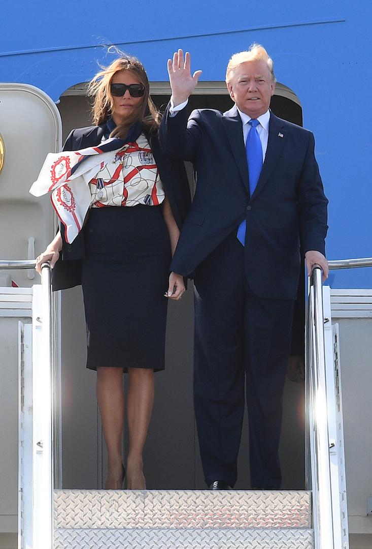 The First Lady touched down in London on June 3 wearing another diplomatic ensemble. This time, the 49-year-old opted for a £650 pussy bow blouse by British fashion house Burberry. A Michael Kors navy skirt suit and co-ordinating courts finished the airport-ready look. [Photo: Getty]