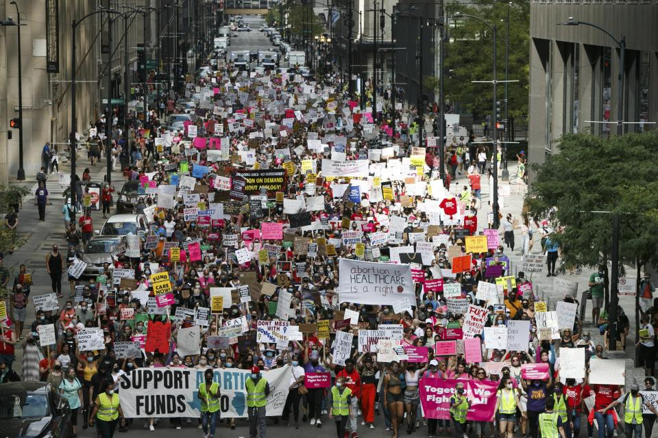 Pro-abortion rights demonstrators take part in a Women's March in Chicago on Saturday, Oct. 2, 2021. Rallies were held in major cities across the country to demand continued access to abortion. (AP Photo/Mark Capapas)