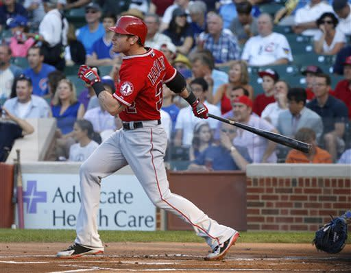 Los Angeles Angels' Josh Hamilton watches his three-run home run off Chicago Cubs starting pitcher Jeff Samardzija during the first inning of an interleague baseball game Wednesday, July 10, 2013, in Chicago. (AP Photo/Charles Rex Arbogast)