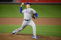 Texas Rangers starting pitcher Spencer Howard delivers during the fourth inning of a baseball game against the Baltimore Orioles, Friday, Sept. 24, 2021, in Baltimore. (AP Photo/Nick Wass)