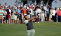 Tiger Woods watches his shot on the first hole during fourth round play at the Dell Technologies Match Play Championship golf tournament, Saturday, March 30, 2019, in Austin, Texas. (AP Photo/Eric Gay)