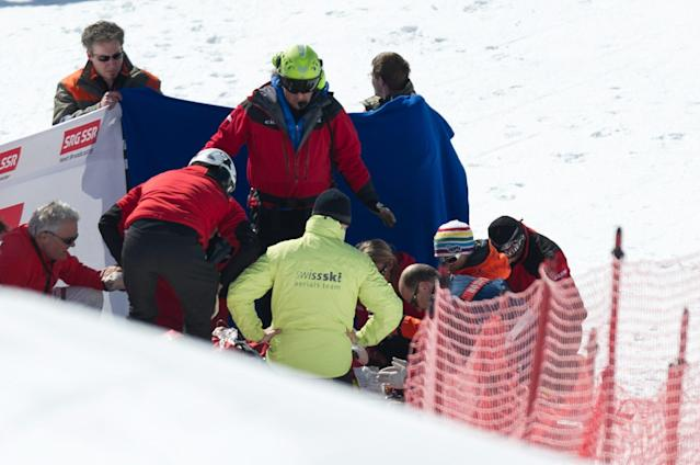 Staff members and medical assistants try to reanimate Canada`s Nick Zoricic who has crashed hardly after the finish jump during the skicross world cup finals, Saturday March 10, 2012 in Grindelwald, Switzerland . The race has been cancelled after the accident. (AP Photo/Keystone/Samuel Truempy)
