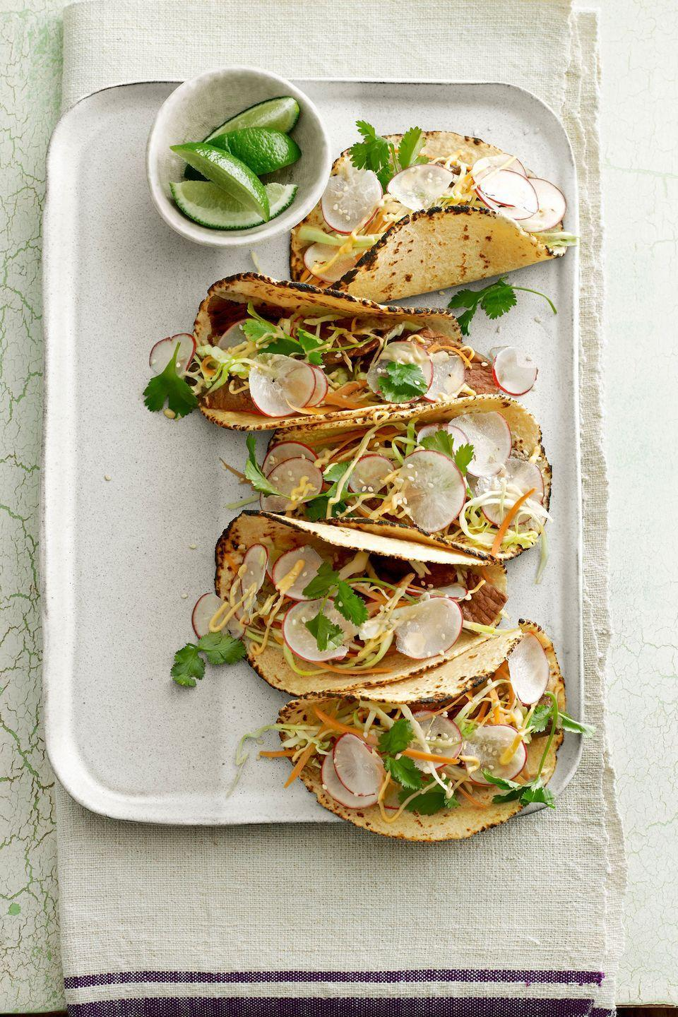 "<p>Try juicy Thai-marinated steak for a new spin on usual tacos. Plus, these are ready in just 30 minutes! </p><p><a href=""https://www.countryliving.com/food-drinks/recipes/a4169/thai-steak-tacos-recipe-clv0513/"" rel=""nofollow noopener"" target=""_blank"" data-ylk=""slk:Get the recipe."" class=""link rapid-noclick-resp""><strong>Get the recipe.</strong></a></p>"