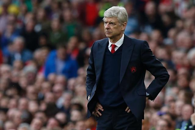 Arsenal's manager Arsene Wenger, pictured in April 2017, has been a source of endless speculation as he has been tight lipped about whether he will sign an extension to his contract, which is up at the end of the season (AFP Photo/Ian KINGTON)