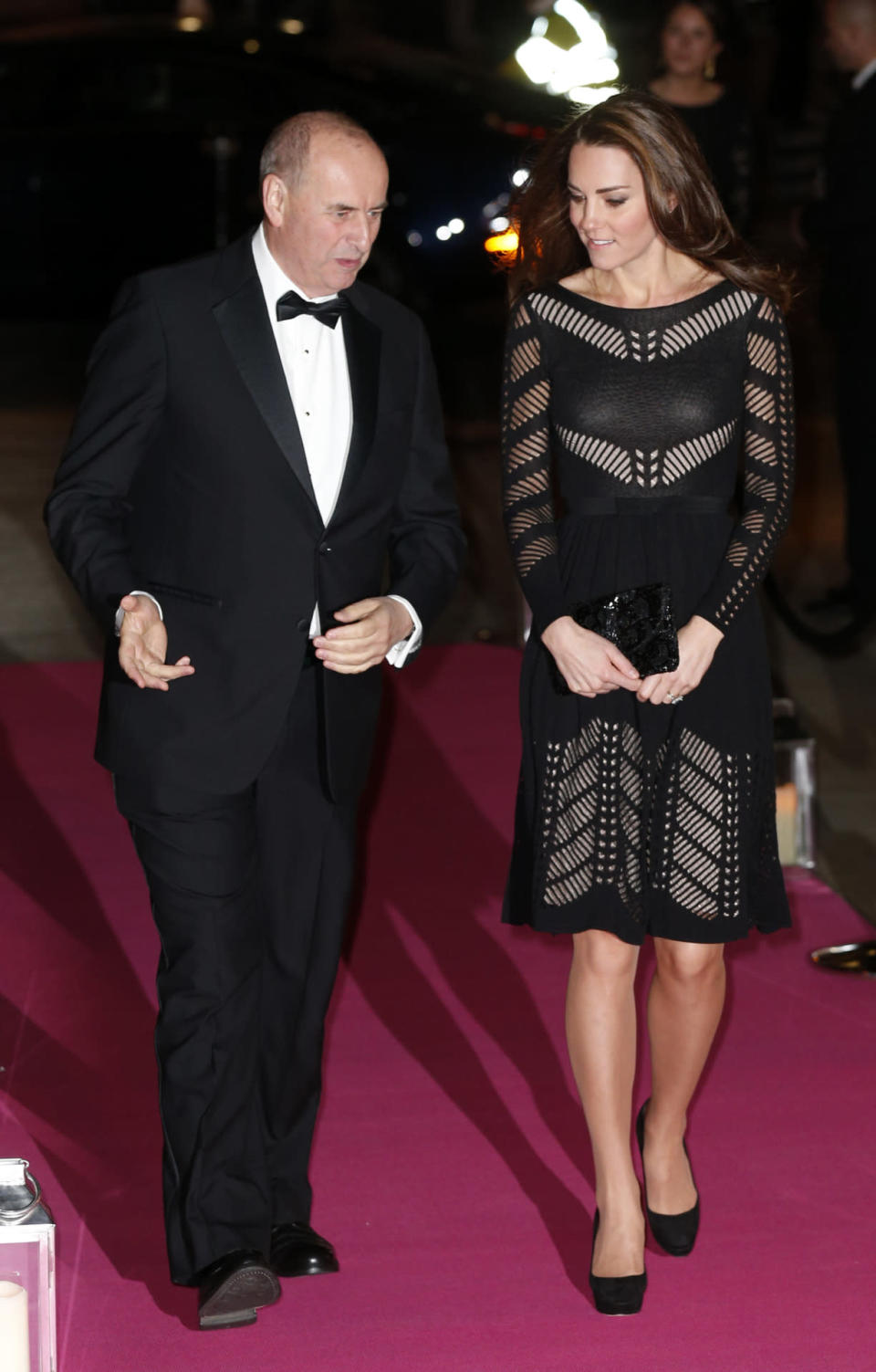 <p>For a charity dinner in London, Kate turned up in a black knitted dress by Temperley London. She completed the look with a black beaded clutch and Jimmy Choo heels. </p><p><i>[Photo: PA]</i></p>