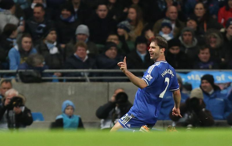 Chelsea's Branislav Ivanovic celebrates after scoring the opening during their English Premier League soccer match between Manchester City and Chelsea at the Etihad Stadium, Manchester, England, Monday, Feb. 3, 2014. (AP Photo/Jon Super)