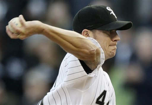 Chicago White Sox starter Jake Peavy throws against the Seattle Mariners during the first inning of a baseball game in Chicago, Friday, June 1, 2012. (AP Photo/Nam Y. Huh)