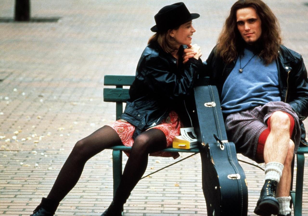 <p>Black leather jacket, minidress, black tights, and booties — not only has Bridget Fonda's outfit somehow not aged at all — it basically just looks like the L train on any given Tuesday. Wish we could say the same for Matt Dillon's very Pearl Jam man-shorts lewk. (Photo: Everett Collection) </p>