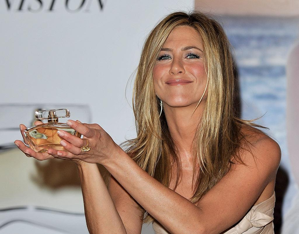 "Jennifer Aniston wowed the crowd at Harrods department store in London Wednesday with the debut of her sweet-smelling eponymous fragrance. ""It's a combination of my favorite scents -- the ocean, sea air, blooming jasmine, and tropical oils. It's my memories of California nights in the summer,"" said Aniston at the event. Gareth Cattermole/<a href=""http://www.gettyimages.com/"" target=""new"">GettyImages.com</a> - July 21, 2010"