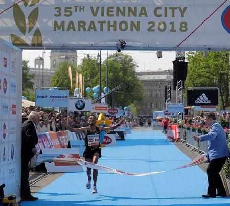 Salaheddine Bounasser of Morocco crosses the finish line to win the Vienna City Marathon in Vienna, Austria, April 22, 2018. REUTERS/Heinz-Peter Bader