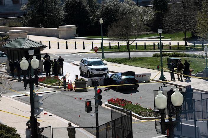 Law enforcement investigate the scene after a vehicle charged a barricade at the U.S. Capitol on April 02, 2021 in Washington, DC. (Win McNamee/Getty Images)