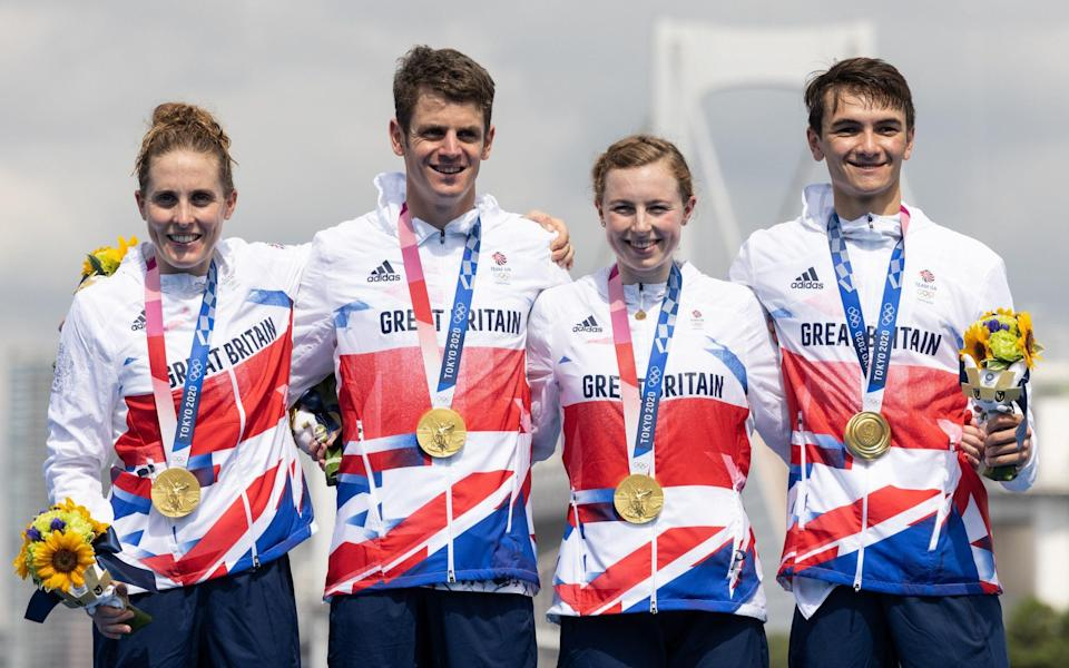 Jessica Learmonth, Jonathon Brownlee, Georgia Taylor-Brown and Alex Yee of Team Great Britain celebrate on the podium during the medal ceremony following the Mixed Relay Triathlon on day eight of the Tokyo 2020 Olympic Games at Odaiba Marine Park on July 31, 2021 in Tokyo, Japan - Getty Images