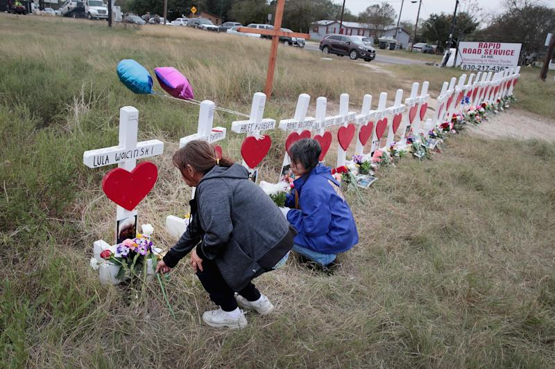 Visitors leave flowers at a memorial for the 26 people killed at the First Baptist Church of Sutherland Springs. (Scott Olson/Getty Images)