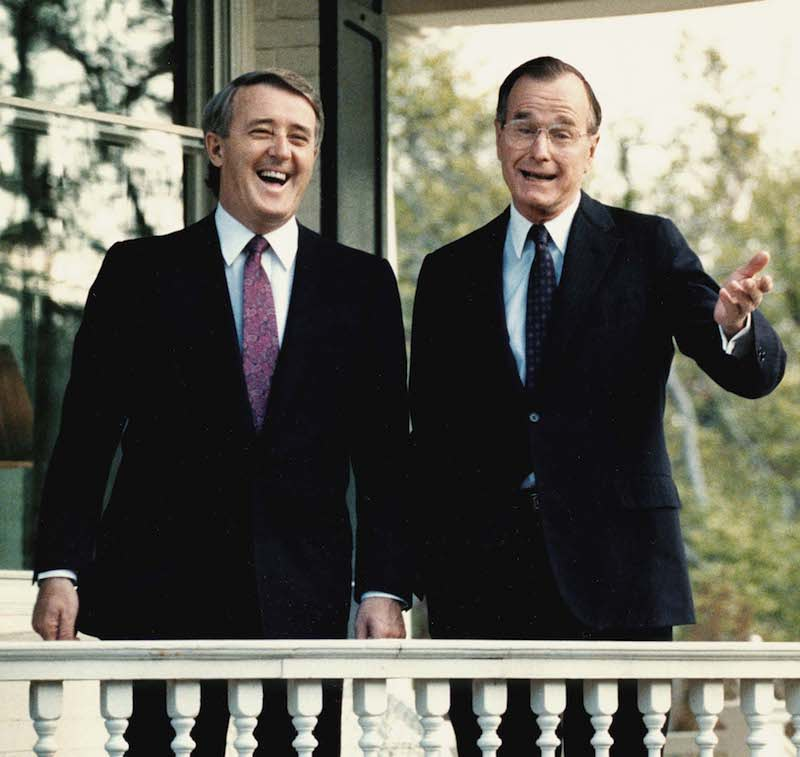 <p>Mulroney and Bush can be seen sharing yet another laugh while taking questions from reporters on April 28, 1988, outside Bush's former residence in Washington, D.C. Photo from Getty Images. </p>