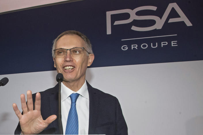 """FILE - In this Wednesday, Feb. 26, 2020 file photo, CEO of PSA Groupe Carlos Tavares arrives for the presentation of the company's 2019 full year results in Rueil-Malmaison, west of Paris. Carmaker Stellantis and Taiwan's Foxconn on Tuesday announced plans to develop a jointly operated automotive supplier focusing on technology to make vehicles more connected, including artificial intelligence-based applications and 5-G communications. Stellantis CEO Carlos Tavares said that the services that will be developed through the tie-up """"will mark the next great evolution of our industry,"""" alongside fully electrified and hybrid powertrains (AP Photo/Michel Euler, File)"""