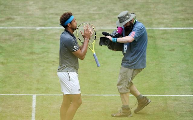France's Jo-Wilfried Tsonga beat compatriot Benoit Paire to set up a second-round meeting with Roger Federer in Halle this week (AFP Photo/Friso Gentsch)