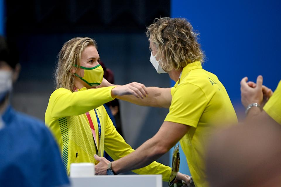 Pictured here, Ariarne Titmus and coach Dean Boxall embrace after her gold medal in the 400m freestyle.