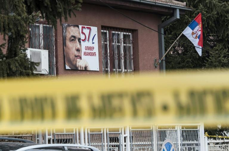 A poster of Kosovo Serb politician Oliver Ivanovic hangs on the wall outside his office in Mitrovica where he was shot dead