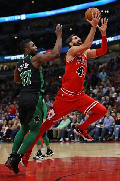 Nikola Mirotic of the Chicago Bulls drives past Semi Ojeleye of the Boston Celtics on his way to a game-high 24 points at the United Center