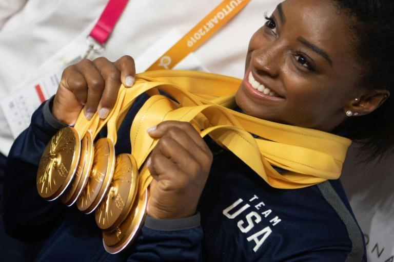 Simone Biles poses with her five gold medals at the world gymnastics championships in Stuttgart