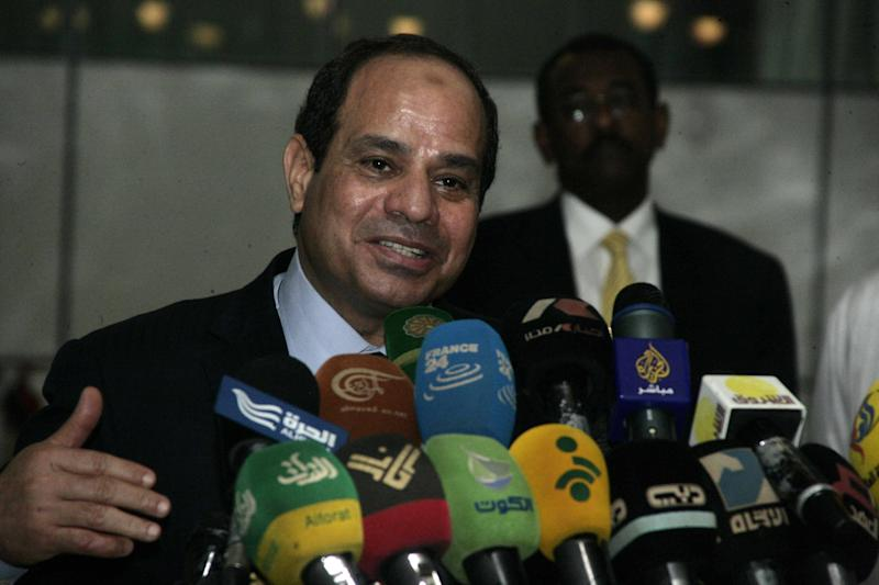Egyptian President Abdel Fattah al-Sisi speaks during a press conference on June 27, 2014 upon arrival at Khartoum airport for an official visit in Sudan