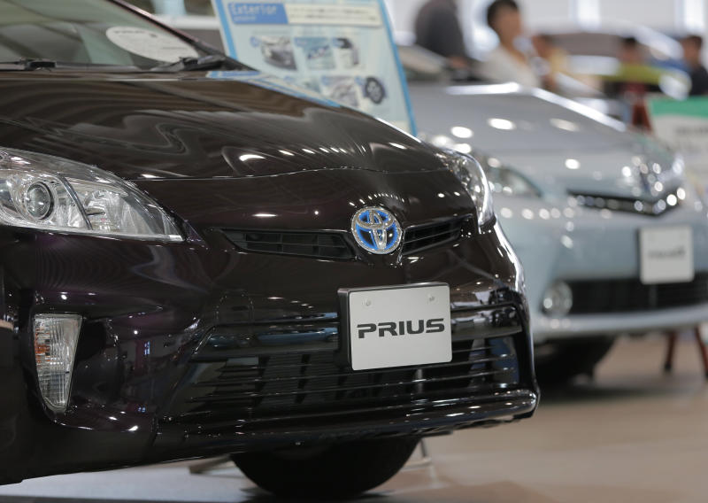 """Toyota's most popular model """"Prius"""" are displaed at a Toyota showroom in Tokyo, Friday, Aug. 3, 2012. Toyota said April-June profit zoomed to 290.3 billion yen ($3.7 billion) from 1.1 billion yen on a jump in global sales as the Japanese automaker makes a comeback from a disaster plagued 2011. (AP Photo/Itsuo Inouye)"""
