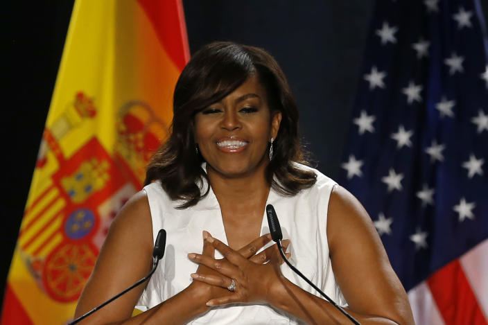 """<p>U.S. first lady Michelle Obama gives a speech on her """"Let Girls Learn"""" initiative to a group of girls and young women in Madrid, Spain, Thursday June 30, 2016. (AP Photo/Francisco Seco) </p>"""