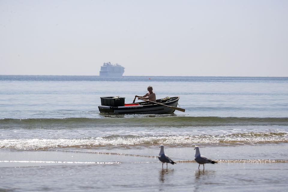 A man rows a boat on the Solent in Bournemouth, Dorset. Picture date: Monday April 19, 2021.