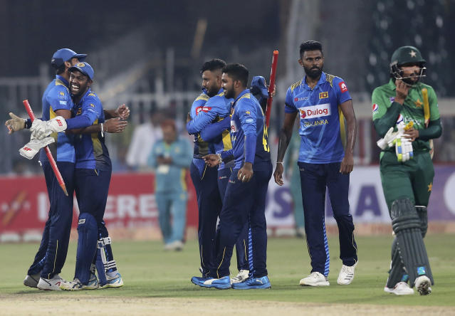 Sri Lankan players celebrate their victory against Pakistan in the second Twenty20 match in Lahore, Pakistan, Monday, Oct. 7, 2019. Sri Lanka's inexperienced team earned another emphatic 35-run victory over top-ranked Pakistan in the second Twenty20 on Monday for an unassailable 2-0 lead in the three-match series.(AP Photo/K.M. Chaudary)