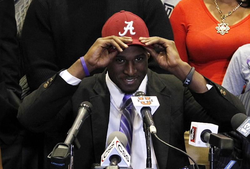 Rashaan Evans chooses Alabama as his commitment to play NCAA college football during national signing day on Wednesday, Feb. 5, 2014, in Auburn, Ala