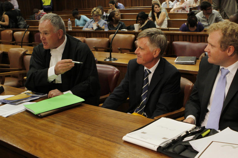 FILE In this file photo taken Thursday, March 28, 2013 the defense team for athlete Oscar Pistorius, led by Barry Roux, left, prepares for a hearing in the Pretoria, South Africa high court opposing the bail conditions of Pistorius who is charged with the shooting death of his girlfriend Reeva Steenkamp. At the start of Pistorius' trial Monday March 3, 2014, prosecutors pressing the murder charge have listed 107 witnesses they're able to call and some will say that the world-famous athlete had a fight with Steenkamp and then intentionally killed her. (AP Photo/Denis Farrell-File)