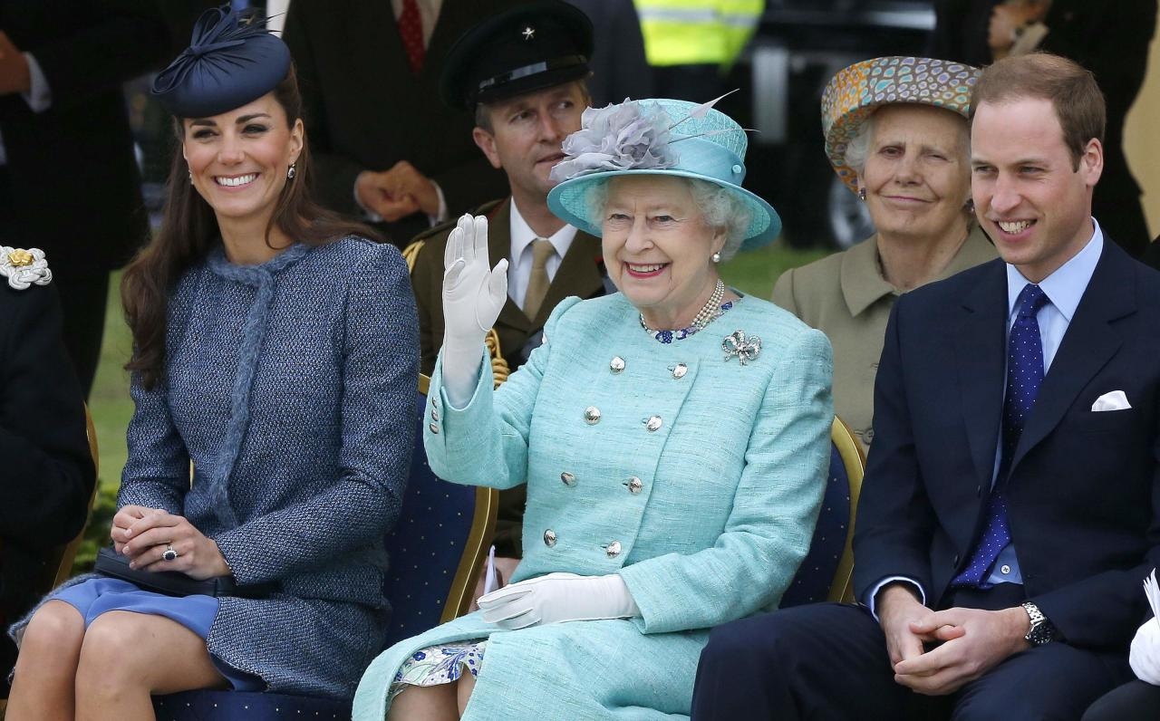 NOTTINGHAM, ENGLAND - JUNE 13:  Catherine, Duchess of Cambridge, Queen Elizabeth II and Prince William, Duke of Cambridge watch part of a children's sports event while visiting Vernon Park during a Diamond Jubilee visit to Nottingham on June 13, 2012 in Nottingham, England.  (Photo by Phil Noble - WPA Pool/Getty Images)